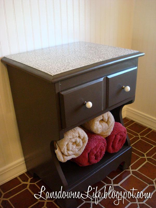 $100 Bathroom Challenge Nightstand repurposed for storage