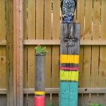 Homemade backyard sculpture: Painted posts