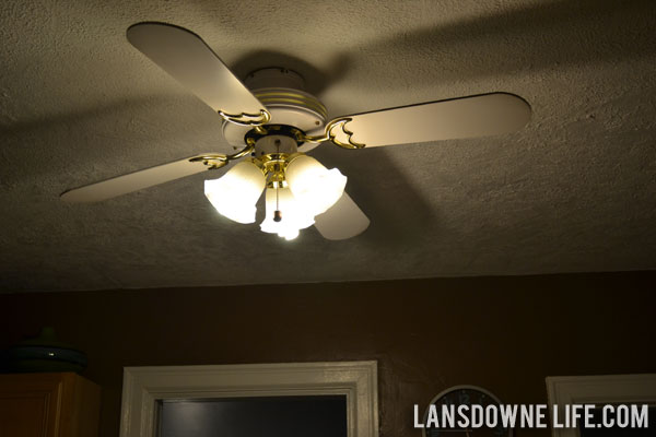 it was time that it made its way up onto our kitchen ceiling to replace this white and shiny brass ceiling fan ugly and definitely not our style ceiling fans ugly