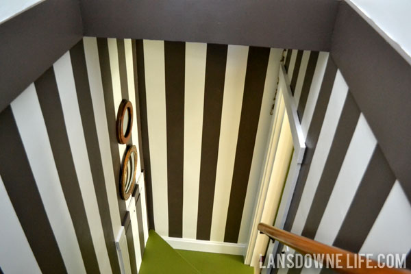 Stairway makeover reveal with green painted stairs and black and white wall stripes