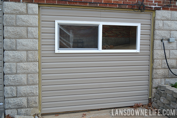 Replacing an old garage door with a wall lansdowne life for Garage door not opening or closing