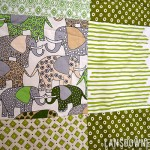 Green patchwork squares baby quilt