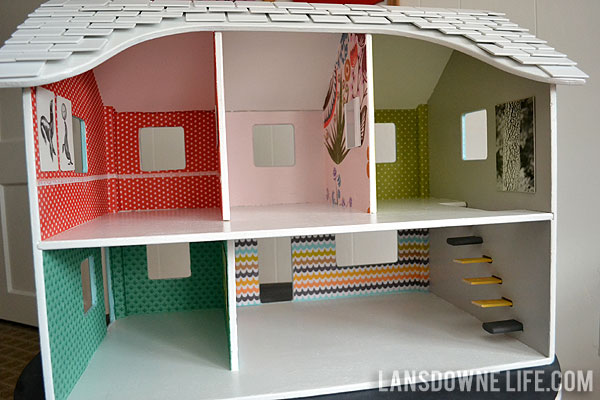 Repainted dollhouse with wallpaper