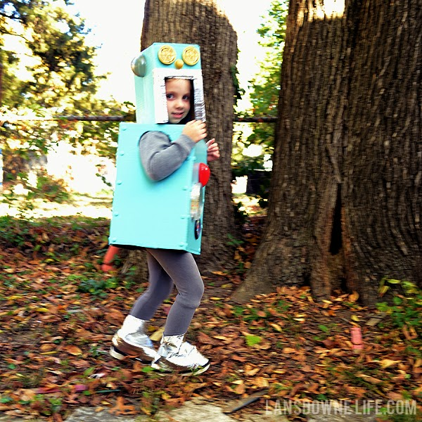 DIY robot costume made from cardboard boxes and junk