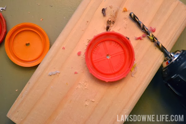 Drilling holes in upcycled lids