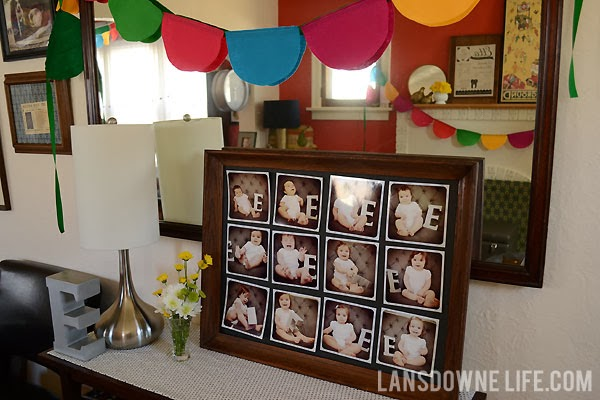 Colorful scalloped birthday party banner and monthly photo display