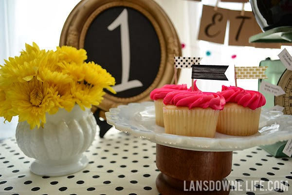 First birthday party featuring black and white polka dots and bright colors