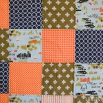Orange and navy blue baby boy quilt