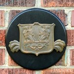 Curb appeal detail: Brass griffin shield plaque