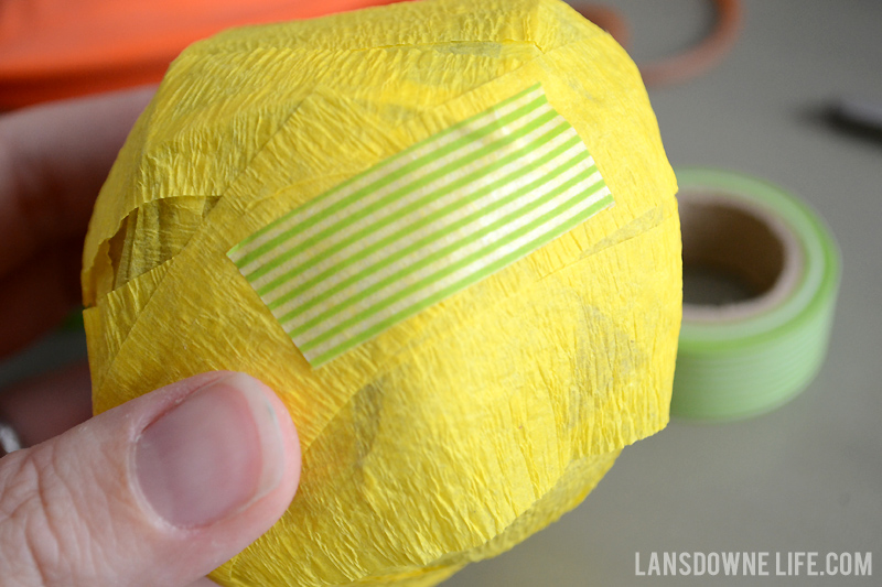 Wrap surprise ball with crepe paper and washi tape