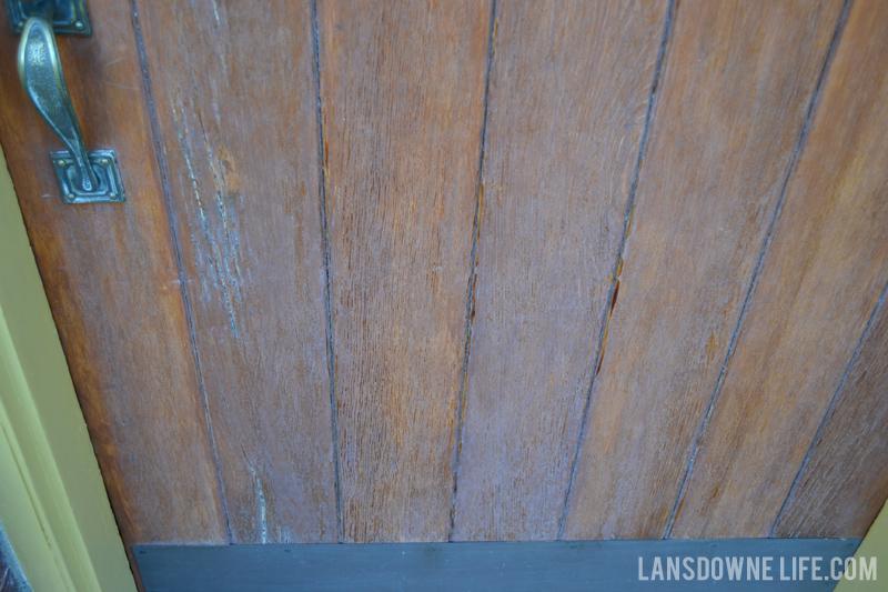 Wood front door finish cracking