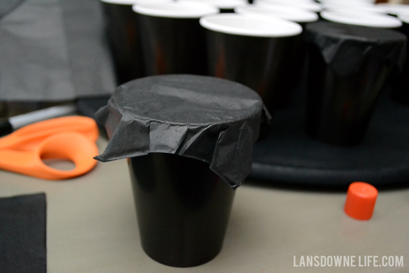 Wrap tissue paper on top of the cups
